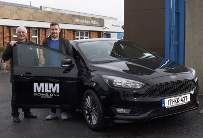 Richie Hogan collects his new 171 Ford Focus ST from Michael Lyng